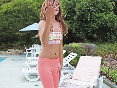 Teen Babe Giving A Hot Striptease By The Pool