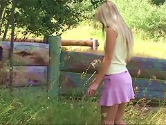 Long Haired Blonde Cutie Enjoys Fingering Her Bald Snatch Outdoors