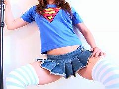 Playful Brunette Honey Poses In A Tiny Mini Skirt